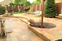 Garden makeover including pond, patio, pergola, planting, block paving, garden wall