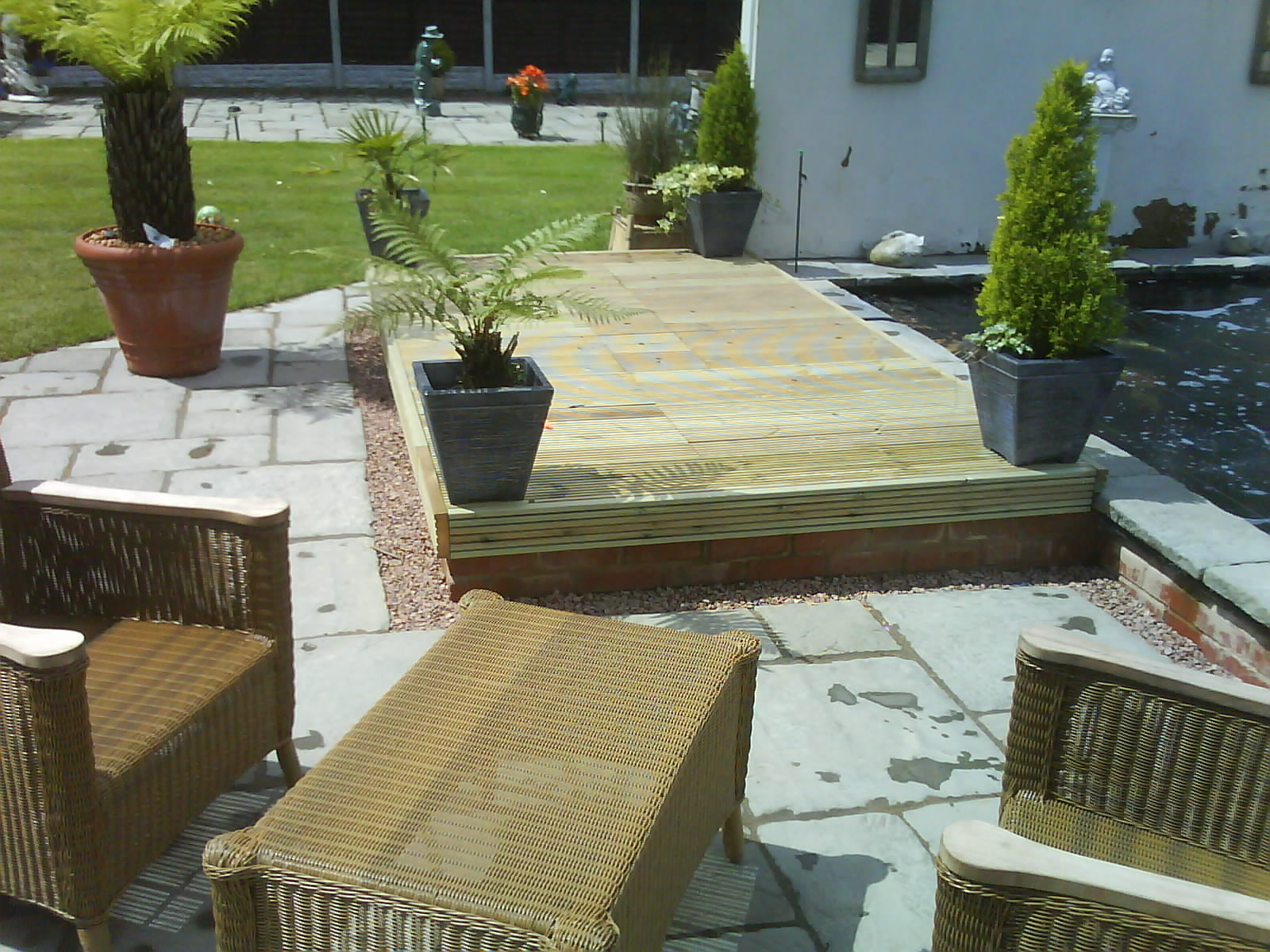 Decking, patio area and extended pond